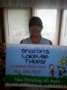 Sharon holding her day care sign